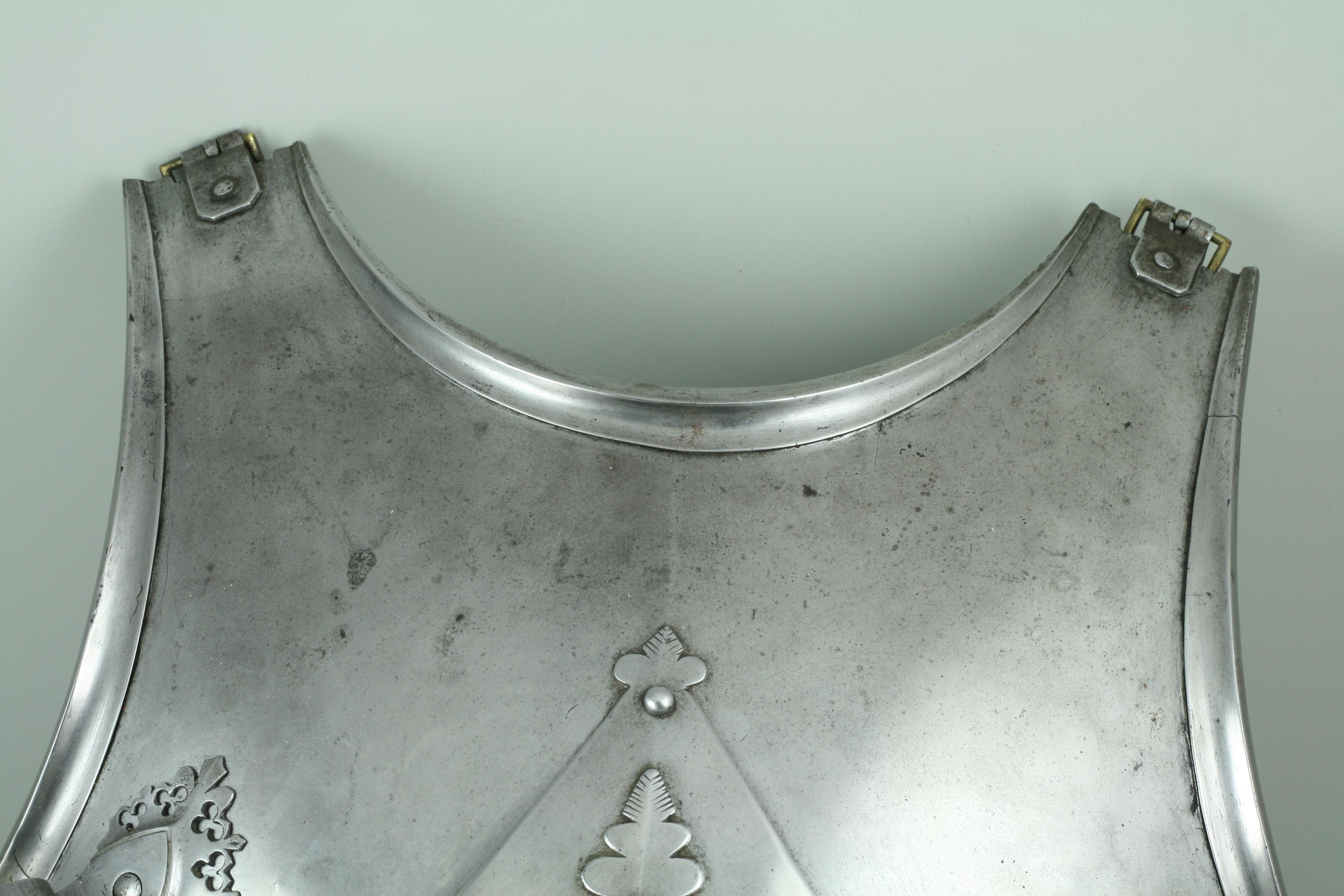 Rolls on the edges of a breastplate