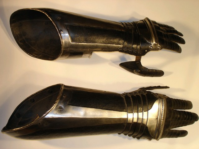 German pair of black and white elbow gauntlets